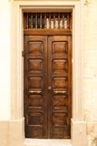 Wooden front door to the house. Old wooden front door to the house in the Mediterranean Stock Images