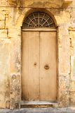 Wooden front door to the house Royalty Free Stock Photo