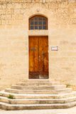Wooden front door to the house. Old wooden front door to the house, stairs in the Mediterranean Royalty Free Stock Photos