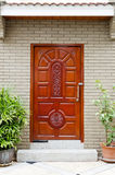 Wooden front door. Of an upscale home. View of a  on a red house  Vertical shot Royalty Free Stock Photo