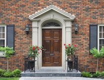 Wooden front door. With flowers Royalty Free Stock Image