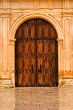 Wooden front doors of San Carlos Cathedral. Wooden front doors of the old San Carlos Cathedral in Monterey, California Royalty Free Stock Photos