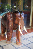 Wooden front hotel door elephant figure, Laos Stock Photos