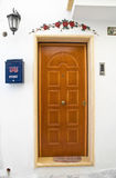 Wooden frontdoor. Royalty Free Stock Images