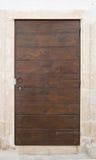Wooden frontdoor. Royalty Free Stock Image