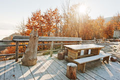 Wooden frost table, benches and stumps on the terrace of teahous Stock Images