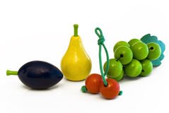 Wooden fruits plum, pear, cherry, grapes Stock Images
