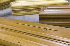 Wooden Funeral coffin For deceased persons. Detail of Wooden coffins used for deceased persons Royalty Free Stock Image