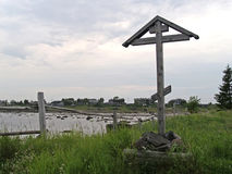 Wooden funeral cross on the bank of the White Sea. Karelia, Russ Royalty Free Stock Photography