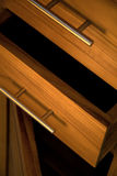 Wooden furniture. Detail of wooden furniture with drawers stock photos