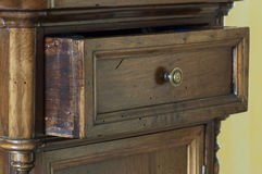 Wooden furniture. Detail of wooden furniture with drawers Royalty Free Stock Photo