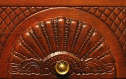 Wooden furniture detail. Brown wooden furniture cabinet detail Stock Photo