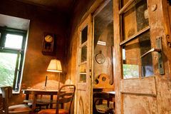 Wooden furniture, doors and lamps inside the cafe in the style of old apartment Royalty Free Stock Images