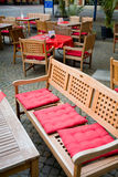 Wooden furniture in european street cafe Royalty Free Stock Photo