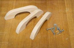 Wooden furniture handles, made of alder Royalty Free Stock Images