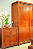 Wooden furniture in living room. Wooden cabinet and flower decoration in living room, shown as luxury, featured and comfortable life style Royalty Free Stock Photo