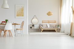 Wooden furniture in modern style. In spacious living room Stock Image