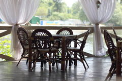 Wooden furniture on the summer terrace Royalty Free Stock Photography