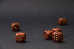 Wooden gambling dices on black background Royalty Free Stock Photos