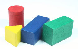 Wooden game block. 4 wooden game block in diferent shaps and colors Royalty Free Stock Photo