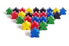 Wooden game figures. An army of wooden game figures  on white background Royalty Free Stock Image