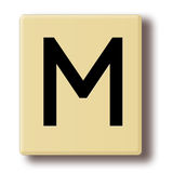 Wooden game tile with the letter M Stock Images