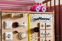 Wooden gaming board develops bizibord. Dashboard for children Stock Image