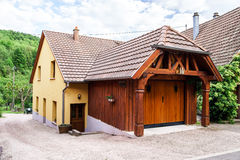 Wooden garage builded near village house Royalty Free Stock Image