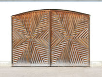 Wooden garage door with star-shaped carving Stock Photography
