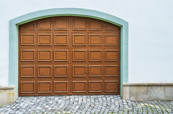 Aged italian brick wall with arched doorway royalty free Italian garage doors