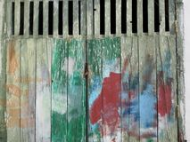 Wooden garage doors in different colors in Procida Italy royalty free stock photo
