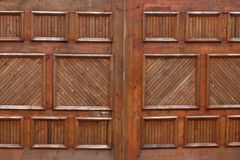 Wooden garage doors on an upscale house . royalty free stock images