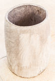 Wooden garbage. On sand wash floor Royalty Free Stock Photography