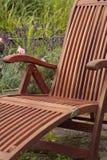 Wooden garden chair. Wooden folding chair in garden Stock Photo