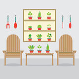 Wooden Garden Chairs And Pot Plants Royalty Free Stock Image
