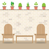 Wooden Garden Chairs With Table And Pot Plants Stock Image