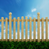 Wooden garden fence. Against the blue sky Royalty Free Stock Photo