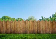 Free Wooden Garden Fence At Backyard And Trees Stock Images - 216014454