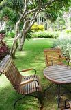 Wooden garden furniture and landscaping royalty free stock photos