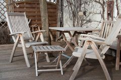 Wooden garden furniture with table and chair stock images