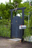 Wooden Garden Gate with Deer Antler and Mailbox Stock Photos
