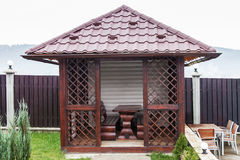 Wooden garden house for relaxing. Metal tiles roof Royalty Free Stock Image