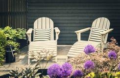 Wooden garden loungers Royalty Free Stock Photos