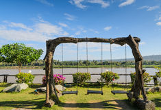 Wooden garden swing Royalty Free Stock Images