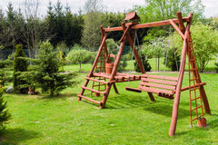 Wooden garden swing Royalty Free Stock Image