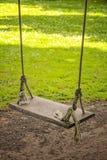Wooden garden swing Stock Images