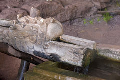 Wooden gargoyle in the temple of Wat Phu Royalty Free Stock Images