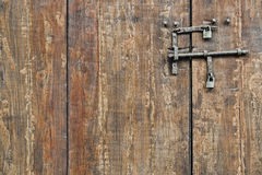 Wooden gate. With bolts and padlocks Royalty Free Stock Image