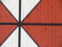 Wooden gate. With a red and white pattern Stock Photos