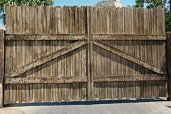 Wooden Gate. Entrance with a wooden gate, blocking passage royalty free stock images